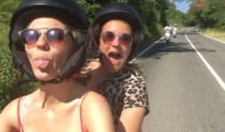 Two girls traveling with the vespa in tuscany